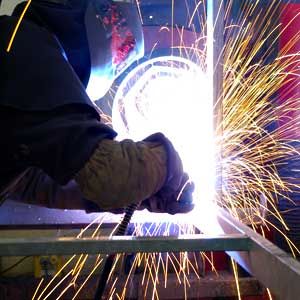 Welder welding at Weldwell Fabrication Ltd, Telford, Shropshire
